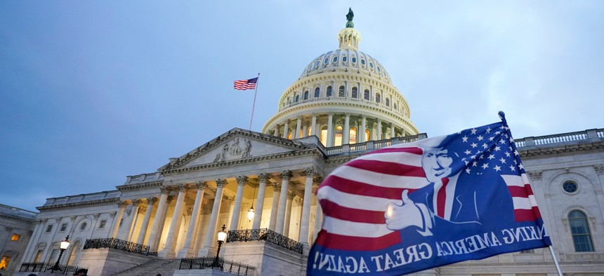 After storming the Capitol Building in a riot, Trump supporters left a flag outside the Capitol, Wed., Jan. 6, 2021, in Washington.