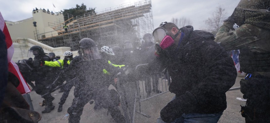 Trump supporters try to break through a police barrier, Wednesday, Jan. 6, 2021, at the Capitol in Washington.