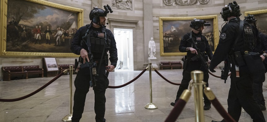 Members of the U.S. Secret Service Counter Assault Team walk through the Rotunda as they and other federal police forces responded as violent protesters loyal to President Donald Trump stormed the U.S. Capitol today, Wednesday.