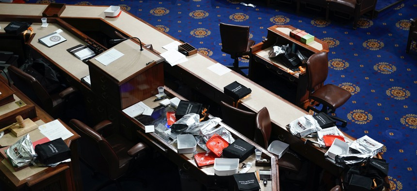 Papers and other equipment after the House floor was evacuate as protesters tried to break into the House Chamber at the U.S. Capitol on Wednesday, Jan. 6, 2021, in Washington.
