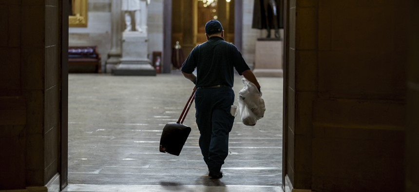 A workman walks through the Rotunda after cleaning debris outside the office of Speaker of the House Nancy Pelosi on the day after violent protesters loyal to President Donald Trump stormed the U.S. Congress.