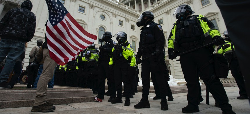 U.S. Capitol Police officers push back demonstrators who were trying to break into the U.S. Capitol on Wednesday, Jan. 6, 2021, in Washington.