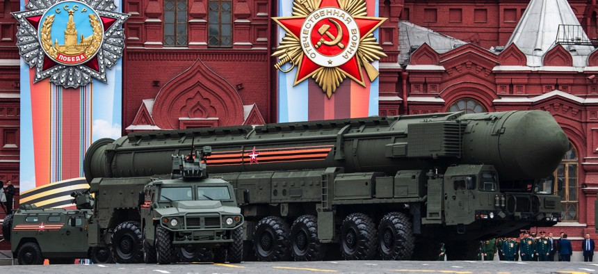 A Russian Topol-M intercontinental ballistic missile launcher rolls in Moscow, Russia, on May 9, 2019.