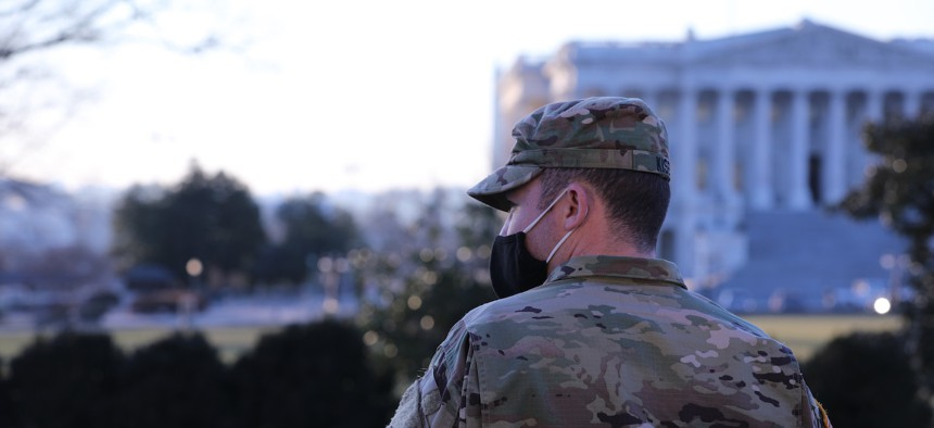 A Virginia National Guardsman stands near the Capitol building in Washington, D.C., Jan. 12, 2021.