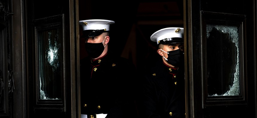 U.S. Marine Corps. hold the damaged Capitol doors during a rehearsal for the 59th inaugural ceremony for President-elect Joe Biden and Vice President-elect Kamala Harris on Monday, Jan. 18, 2021 at the U.S. Capitol in Washington.