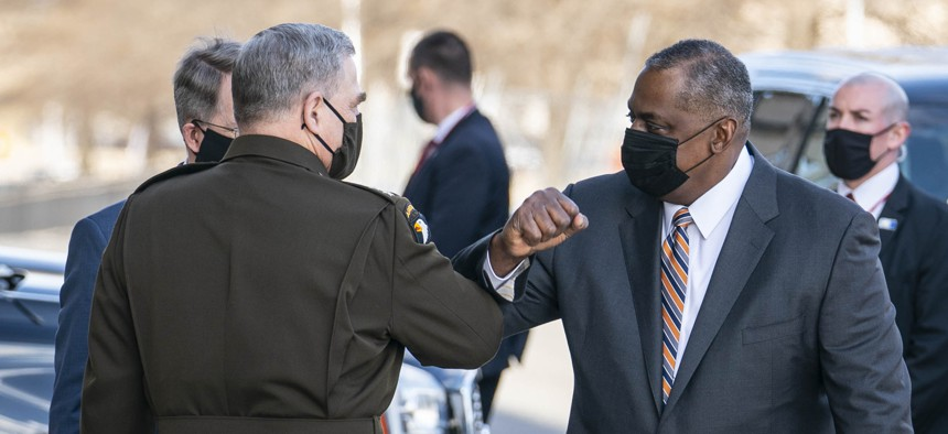 Mark Milley, chairman of the Joint Chiefs of Staff, greets incoming Secretary Of Defense Lloyd Austin III outside of the Pentagon on Austin's first day in his new role on January 22, 2021 in Arlington, Virginia.