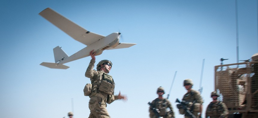 U.S. Army Chief Warrant Officer 2 Dylan Ferguson, a brigade aviation element officer with the 82nd Airborne Division's 1st Brigade Combat Team, launches a Puma unmanned aerial vehicle June 25, 2012, Ghazni Province, Afghanistan.