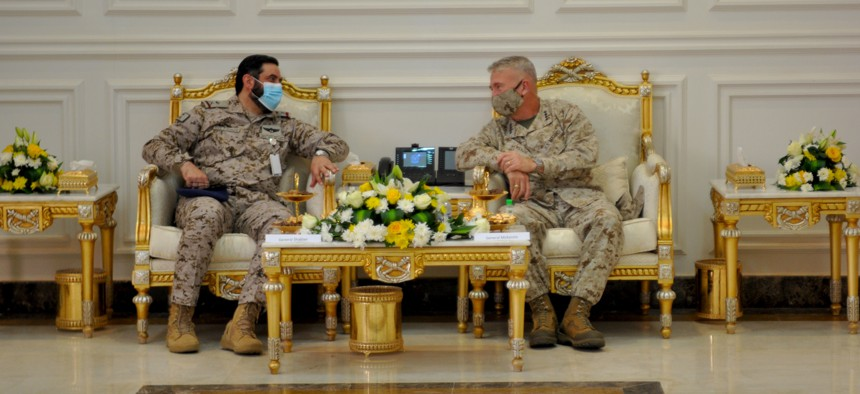 U.S. Marine Corps Gen Frank McKenzie, CDR, U.S. Central Command sits with Saudi Arabian Maj. Gen. Khalid bin Abdullah AlShablan, commander, Prince Sultan Air Base, during a visit to Prince Sultan Air Base, Kingdom of Saudi Arabia, July 9, 2020.