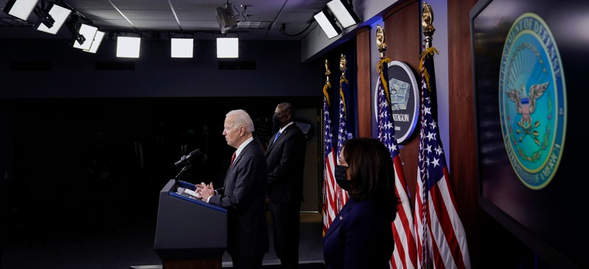 President Joe Biden speaks as Secretary of Defense Lloyd Austin and Vice President Kamala Harris accompany him at the Pentagon, February 10, 2021, in Washington, DC. - Harris and Biden are visiting the Pentagon for the first time since taking office.