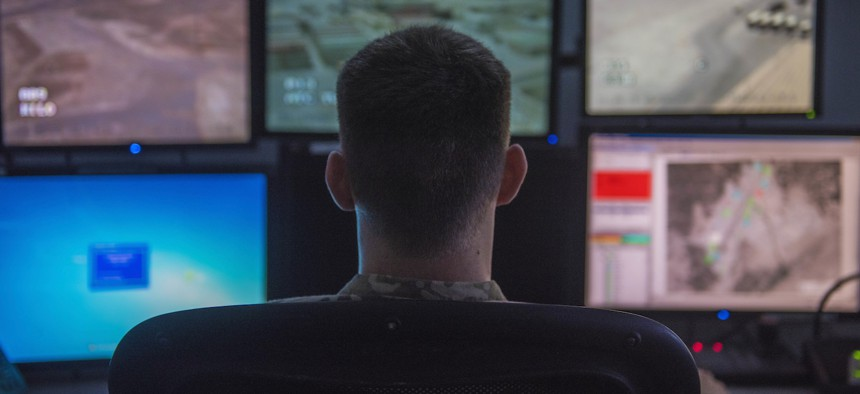 Staff Sgt. Dakota Karlsen, 455th Expeditionary Security Forces Squadron, echo sector controller, looks at a monitor of the surrounding area around the base, Bagram Airfield, Afghanistan, Aug. 4, 2016.