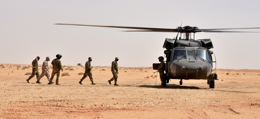 The authors argue that more funding should be driven by combatant commanders such as U.S. Central Command's Gen. Kenneth McKenzie, seen here boarding a UH-60 Black Hawk in Saudi Arabia in 2020.