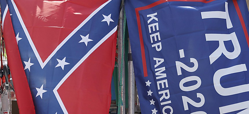 "A vendor displays a confederate and Trump 2020 ""Make America Great Again!"" flag outside of the Bristol Motor Speedway prior to the NASCAR Cup Series All-Star Race at Bristol Motor Speedway on July 15, 2020."