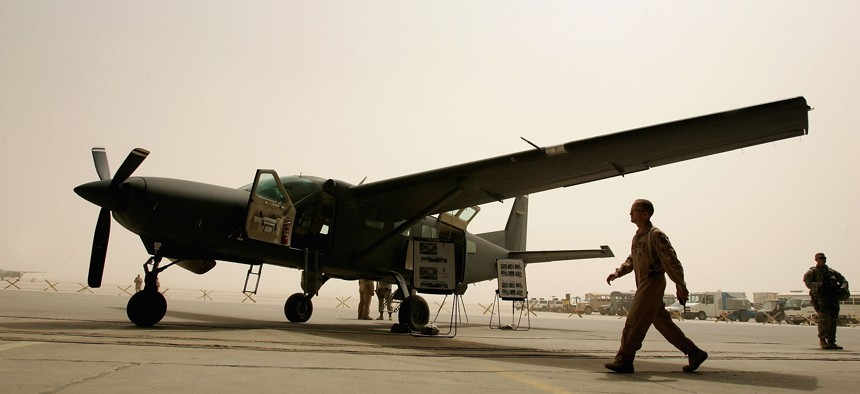 Iraqi air force members and their U.S trainers are seen near the Iraqi air force Caravan (Cessna 280) Intelligence, Surveillance and Reconnaissance (ISR) aircraft on July 30, 2008 at the New Al Muthana Air Base in Baghdad, Iraq.