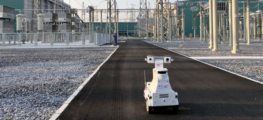ZHUMADIAN, CHINA - AUGUST 27: A 5G intelligent robot inspects the equipment at a 800 kV ultra-high voltage (UHV) electrical substation operated by State Grid Henan Electric Power Co., Ltd on August 27, 2020 in Zhumadian, Henan Province of China.