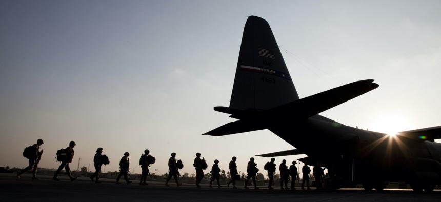BAGHDAD, IRAQ: Amer, ... ]