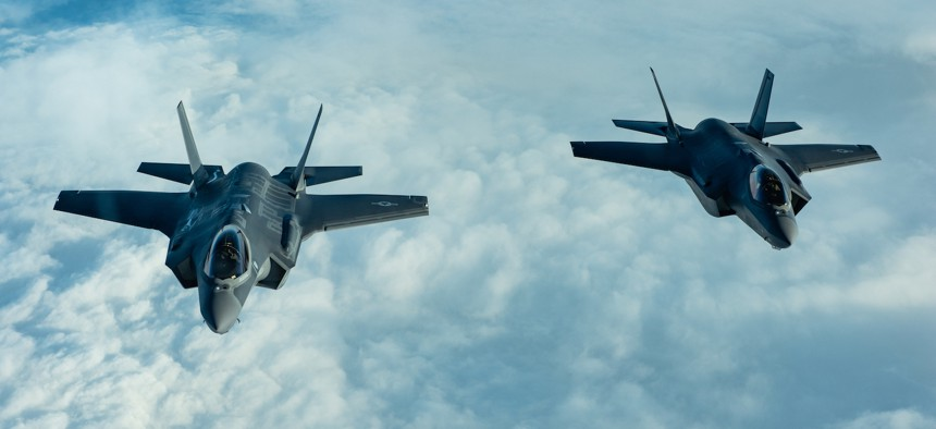 Two F-35A Lightning IIs fly over the Atlantic Ocean in 2018.
