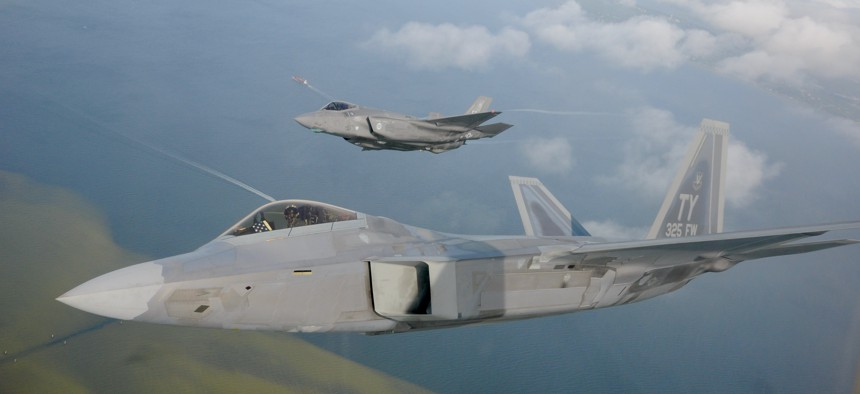 A F-22 Raptor from the 325th Fighter Wing flies alongside a F-35 Lightning II from the 33rd Fighter Wing over Florida.