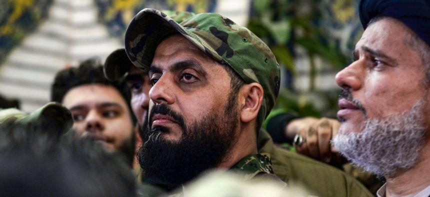 Qais al-Khazali (C) commander of the Asaib Ahl al-Haq pro-Iran faction attends the funeral procession of slain Iraqi paramilitary chief Abu Mahdi al-Muhandis in January 2020.
