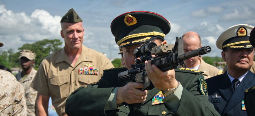 One of the general officers accompanying China's Minister of National Defense shoulders an M4 carbine during a 2012 visit to Marine Corps Base Camp Lejeune, N.C.
