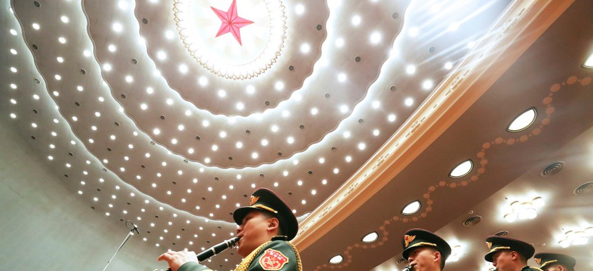 The military band of the Chinese People's Liberation Army performs during the opening meeting of the fourth session of the 13th National People's Congress NPC at the Great Hall of the People in Beijing, capital of China, March 5, 2021.