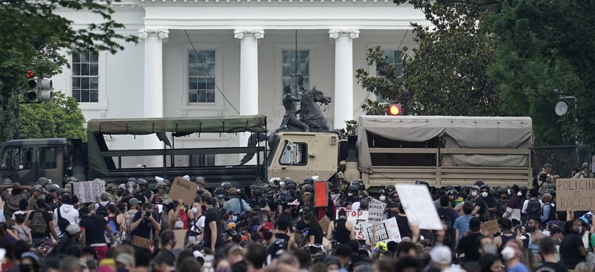 D.C. National Guard vehicles are used to block 16th Street near Lafayette Park and the White House as Demonstrators participate in a peaceful protest against police brutality and the death of George Floyd, on June 3, 2020 in Washington, DC.