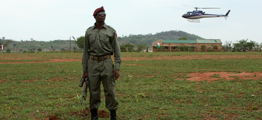 A soldier keeps watch in Mozambique.