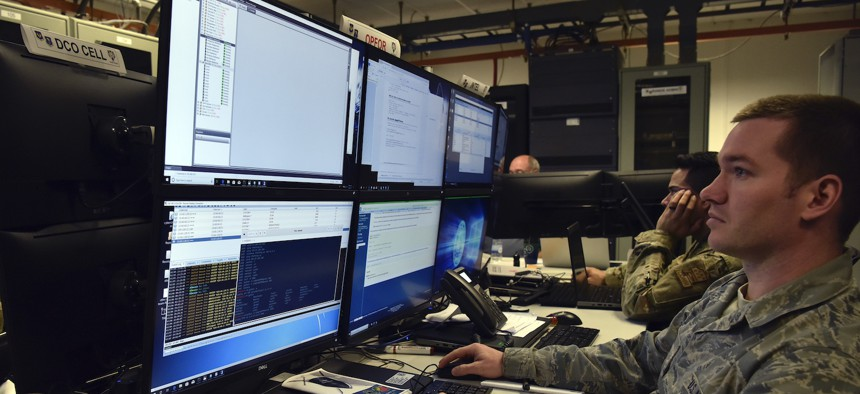 Tech. Sgt. Noe Kaur, a cyber-defense supervisor with the 1st Combat Communications Squadron, uses advanced techniques to launch cyber-attacks to the training audience as part of exercise TACET VENARI.