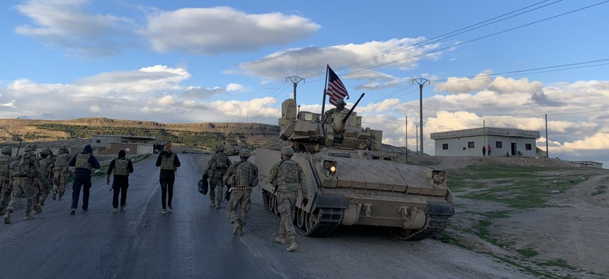 Members of the Louisiana National Guard's 256th Infantry Brigade Combat Team on a presence patrol in far northeastern Syria.