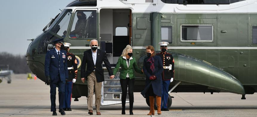 U.S. President Joe Biden and First Lady Jill Biden are greeted by Col. Stephen P. Snelson (L) and his wife, Catherine Snelson (R), as the Bidens arrive to board Air Force One at Joint Base Andrews in Maryland on February 26, 2021.