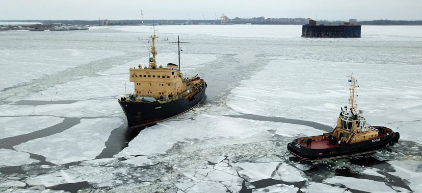 Russia's RB-366 tugboat and the Buran diesel-electric icebreaker break ice in the Gulf of Finland.