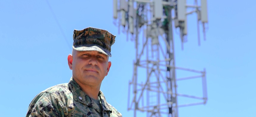 Lt. Col. Brandon Newell, Director of Technology and Partnerships for the Marine Corps Installation Next program poses in front of the new 5G tower installed by Verizon at MCAS Miramar on July 15, 2020.