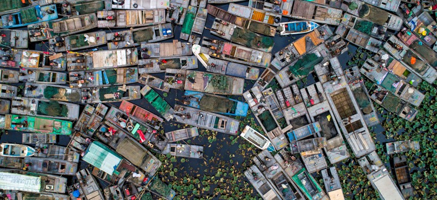 Aerial photo taken on November 3, 2020 shows fishing boats to be dismantled by Hongze Lake after a fishing ban was imposed in the area to protect resources, in Huaian in eastern China's Jiangsu province.