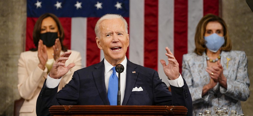 President Joe Biden addresses a joint session of Congress, with Vice President Kamala Harris and House Speaker Nancy Pelosi, D-Calif., on the dais behind him on April 28, 2021 in Washington, DC.