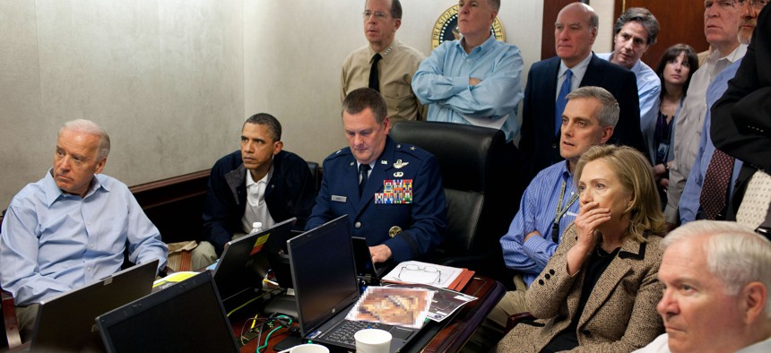 In this handout image provided by The White House, President Barack Obama, Vice President Joe Biden, Secretary of State Hillary Clinton and members of the national security team receive an update on the mission against Osama bin Laden in the Situation Room of the White House May 1, 2011 in Washington, DC