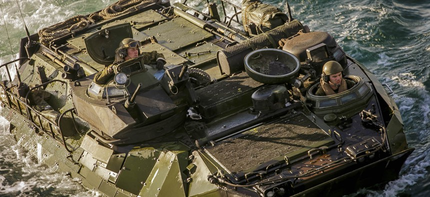 U.S. Marines with the 26th Marine Expeditionary Unit drive a AAV-P7/A1 assault amphibious vehicle into the dock landing ship USS Oak Hill near Onslow Beach, N.C., in November 2017.