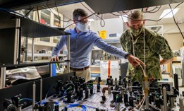 A U.S. Naval Research Laboratory research physicist, shows an atom interferometer to Chief of Naval Research Rear Adm. Lorin Selby Sept. 14, 2020, at Naval Research Labratory facilities in Washington, D.C.