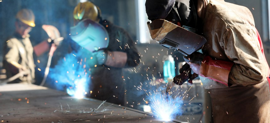 A worker cutting steel at a factory in Huaibei in China's eastern Anhui province.