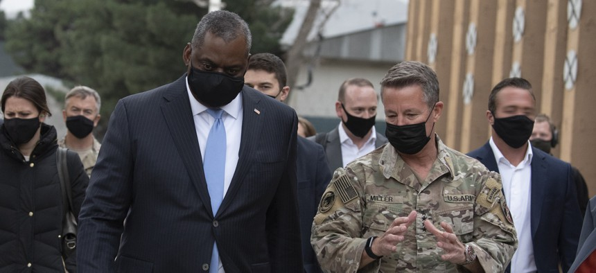 Defense Secretary Lloyd Austin walks with the Army Gen. Scott Miller at Resolute Support Headquarters, Kabul, Afghanistan, March 21, 2021.