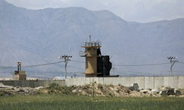 A wall surrounds Bagram Air Base in Afghanistan, May 3, 2021. As U.S. troops pack up to leave Afghanistan, the Americans are dismantling their portion of Bagram, their largest remaining outpost in Afghanistan.