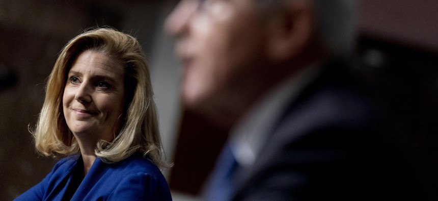 Army Secretary nominee Christine Elizabeth Wormuth smiles as former Defense Secretary Chuck Hagel introduces her during a Senate Armed Services Committee nomination hearing, May 13, 2021.