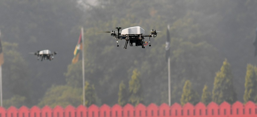 Members of offensive swarm drone system fly drones to demonstrate skills during a ceremony to celebrate India's 73rd Army Day in New Delhi on January 15, 2021.