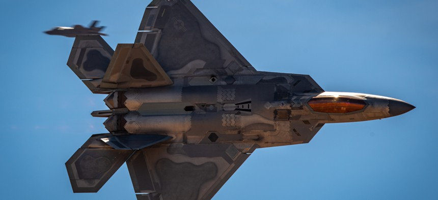 The F-22 Raptor Demonstration Team's commander performs a knife-edge pass at a March airshow.