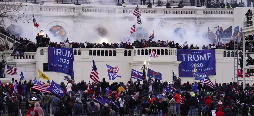 In this Jan. 6, 2021, file photo, violent rioters storm the Capitol, in Washington.