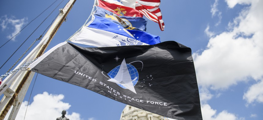 The flags of the service branches outside the Minnesota State Capitol building on May 22, 2021.
