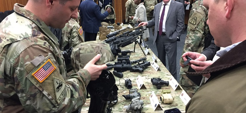 Army Capt. Josh Redmond of Program Executive Office Soldier shows off the new enhanced binocular night-vision goggles helmet during a demonstration at Fort Belvoir, Va., April 17, 2018.