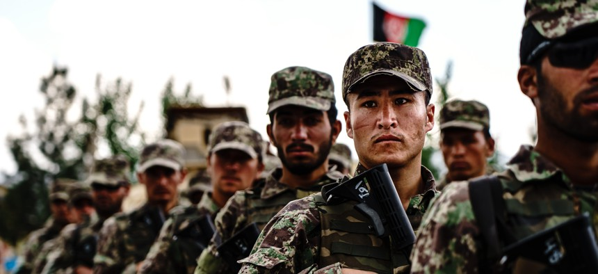 Afghan National Army Special Operations Commandos stand in formation during a visit by Chief of General Staff of the Armed Forces Gen. Mohammad Yasin Zia and his command staff, in Camp Commando, Afghanistan, Wednesday, April 28, 2021.