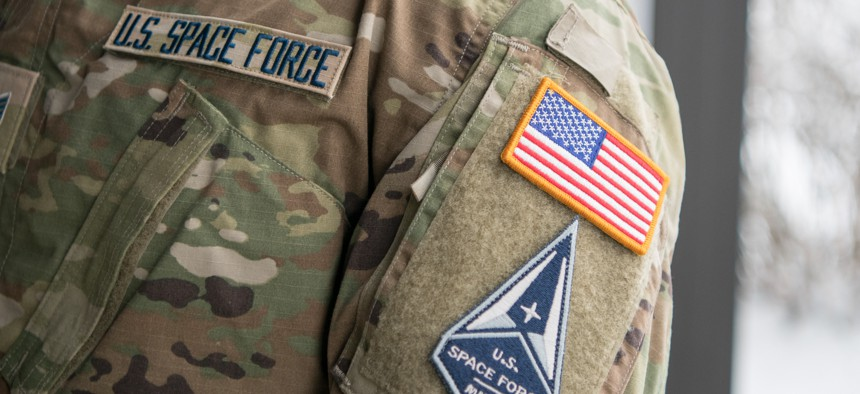 Staff Sgt. David Diehl II, 436th Communications Squadron noncommissioned officer in charge of wing cybersecurity, displays his new United States Space Force tapes and service branch patch at Dover Air Force Base, Delaware, Feb. 12, 2021.