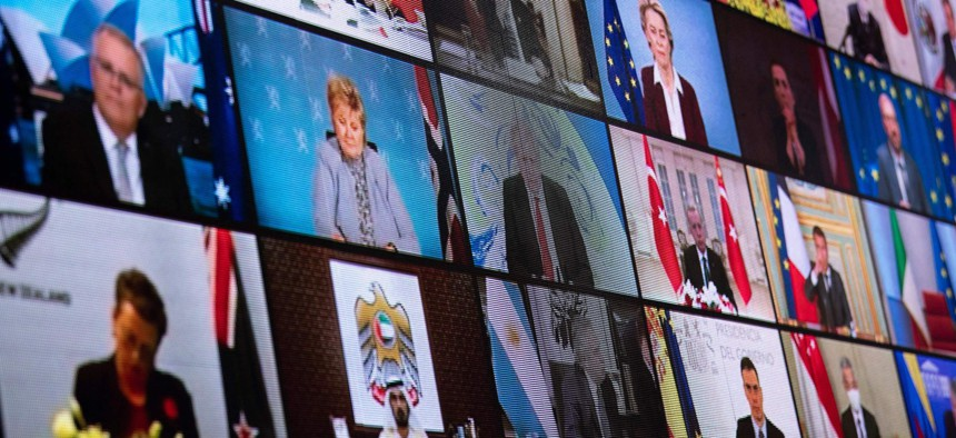 World leaders are seen on a screen during a climate change virtual summit from the East Room of the White House campus April 22, 2021, in Washington, DC.