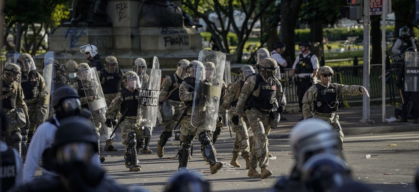Law enforcement responds during a protest near Lafayette Park ahead of President Trump's trip to St. John's Church on June 1, 2020.