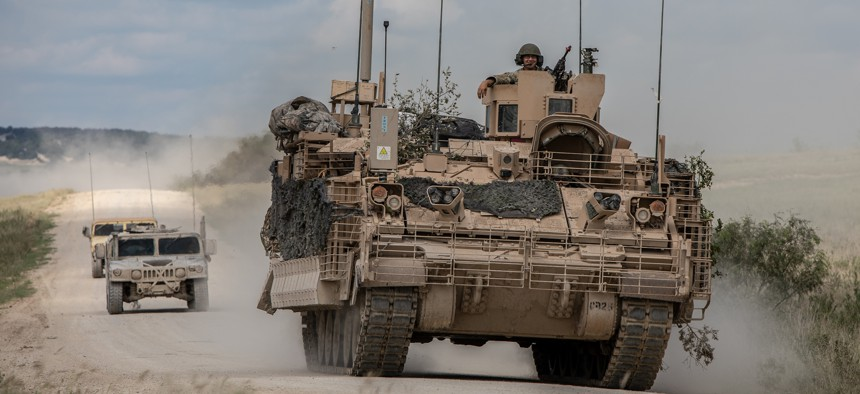 Soldiers are escorted by observer controllers from the U.S. Army Operational Test Command after completing field testing of the Armored Multi-Purpose Vehicle (AMPV) September 24, 2018.